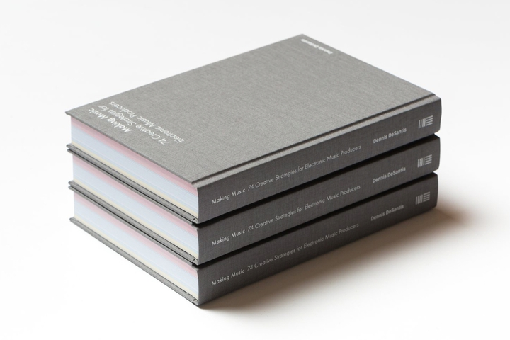 Three copies of the book stacked
