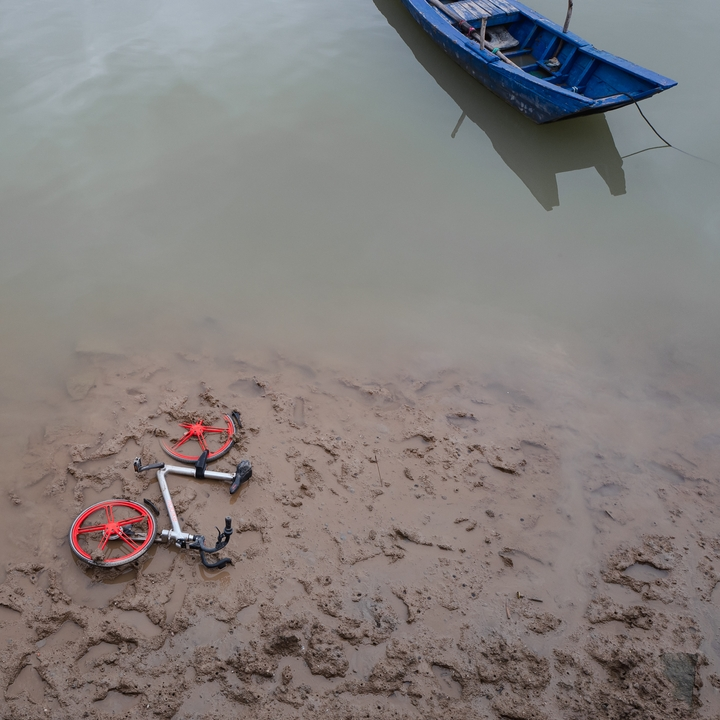a bike share abandoned in the water