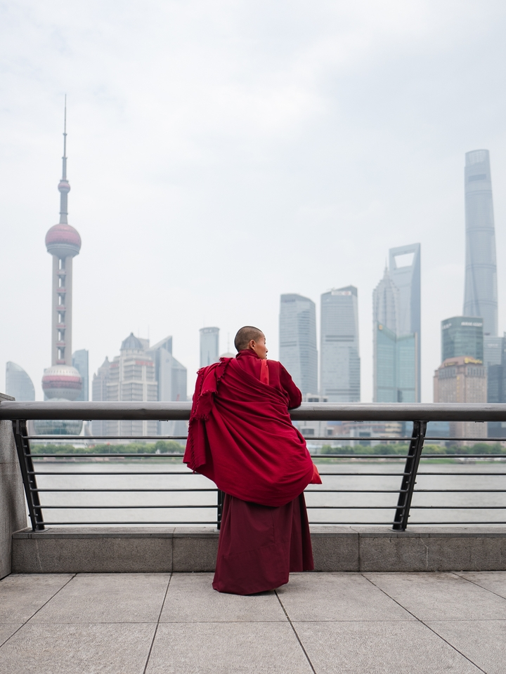 a visiting monk enjoying the view of the Pudong skyline